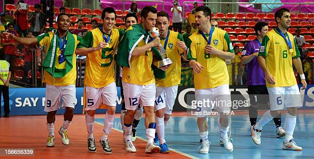 Falcao of Brazil kisses the trophy and celebrates with team mates after winning the FIFA Futsal World Cup Final at Indoor Stadium Huamark on November...
