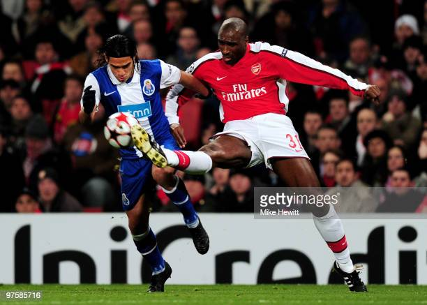 Falcao of Porto is tackled by Sol Campbell of Arsenal during the UEFA Champions League round of 16 match between Arsenal and FC Porto at the Emirates...