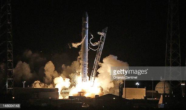 Falcon 9 rocket carrying the Dragon spacecraft blasts off, Tuesday, May 22 from Complex 40 at Cape Canaveral Air Force Station. SpaceX is the first...