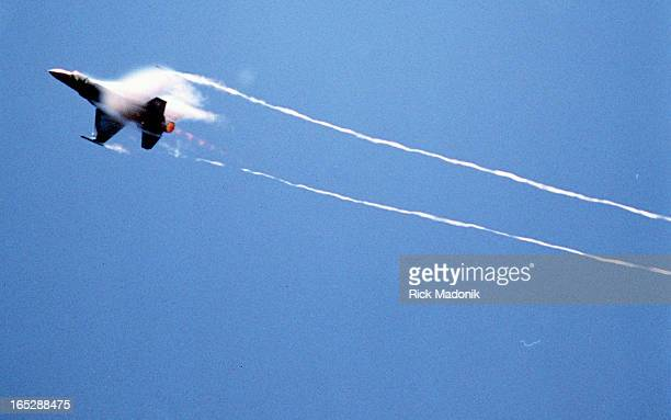 Falcon creates a vapor trail as it pulls a vertical maneuvre during the CNE Air show. The last day of the show featured the jets which were grounded...