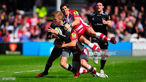 Falcons centre Chris Harris is stopped by James Hook of Gloucester during the Aviva Premiership match between Gloucester Rugby and Newcastle Falcons...