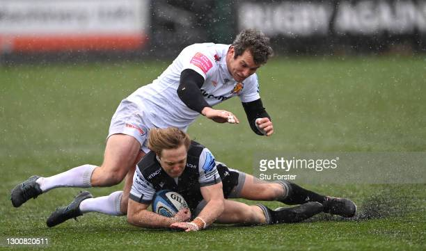 Falcons full back Joel Hodgson collects a loose ball ahead of Chiefs centre Ian Whitten during the Gallagher Premiership Rugby match between...