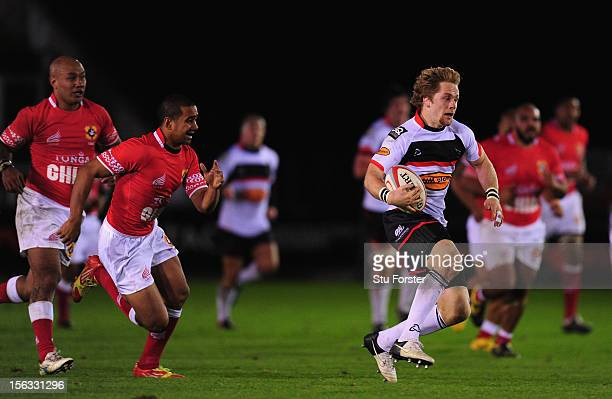 Falcons fullback Alex Tait makes the break to set up the third falcons try during the International Tour match between Newcastle Falcons and Tonga at...