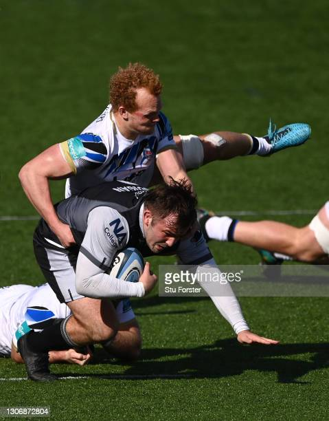 Falcons hooker George McGuigan is tackled by Miles Reid of Bath during the Gallagher Premiership Rugby match between Newcastle Falcons and Bath at...