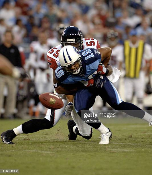 Falcons Michael Boley breaks up a pass attempt for Bobby Wade during first half action between the Atlanta Falcons and the Tennessee Titans on August...