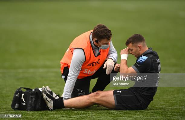 Falcons player Adam Radwan reacts as he receives treatment for an injury during the Gallagher Premiership Rugby match between Newcastle Falcons and...