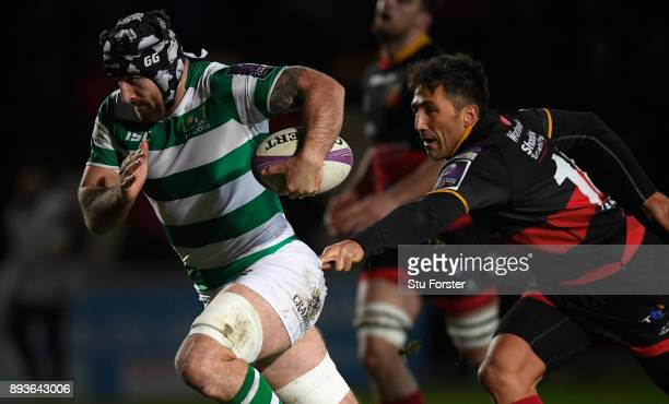 Falcons player Gary Graham breaks through to score the third try despite the attentions of Gavin Henson during the European Rugby Challenge Cup match...