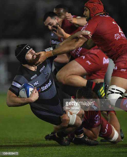 Falcons player Gary Graham is tackled by the Toulon defence during the Champions Cup match between Newcastle Falcons and Toulon at Kingston Park on...