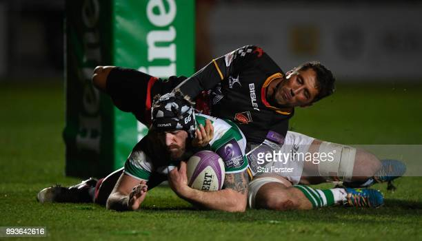 Falcons player Gary Graham scores the third try despite the attentions of Gavin Henson during the European Rugby Challenge Cup match between the...