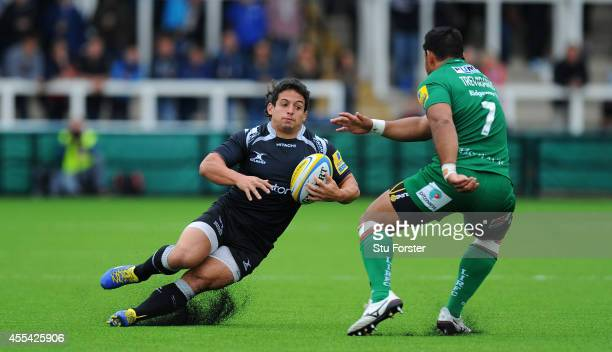 Falcons player Juan Pablo Socino slips on the new artifical pitch as he runs at Ofisa Treviranus during the Aviva Premiership match between Newcastle...