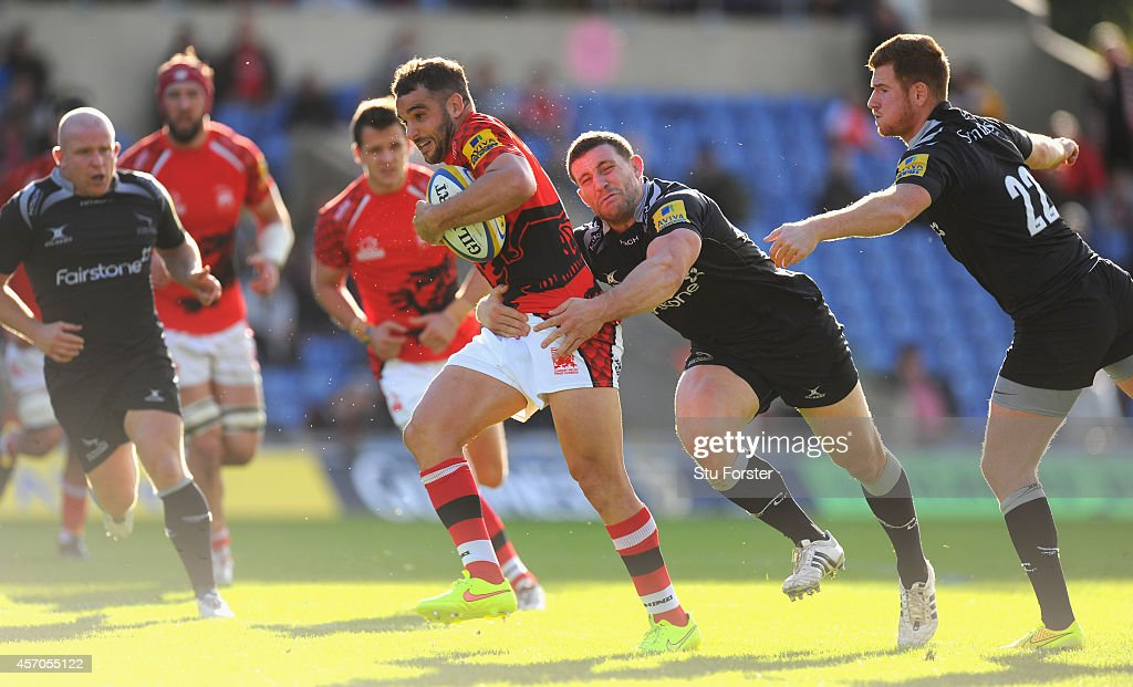 Falcons player Mark Wilson tackles Welsh player Olly Barkley during the Aviva Premiership match between London Welsh and Newcastle Falcons at Kassam Stadium on October 11, 2014 in Oxford, England.