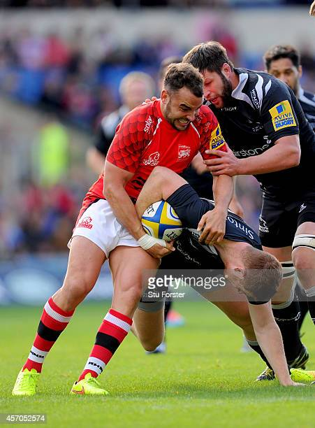 Falcons player Rory Clegg is tackled by Welsh player Olly Barkley during the Aviva Premiership match between London Welsh and Newcastle Falcons at...