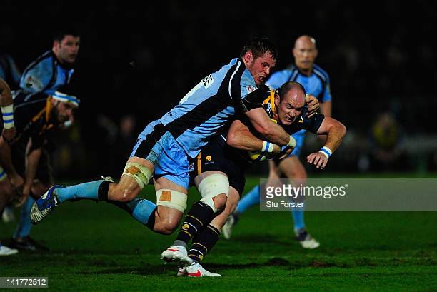 Falcons player Will Welch tackles Warriors scrum half Shaun Perry during the Aviva Premiership match between Worcester Warriors and Newcastle Falcons...