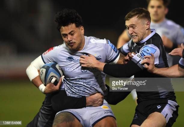 Falcons players Ben Stevenson and Brett Connon combine to tackle Sale wing Denny Solomona during the Gallagher Premiership Rugby match between...