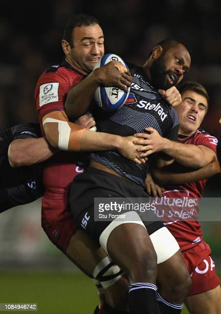 Falcons Vereniki Goneva is tackled by Mamuka Gorgodze and Louis Carbonel during the Champions Cup match between Newcastle Falcons and Toulon at...
