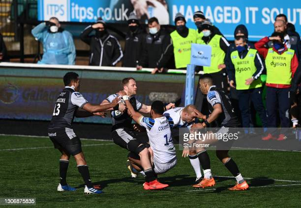 Falcons wing Alex Tait is tackled by Joe Cokansiga whilst support staff wearing PPE and face coverings look on from the sidelines during the...
