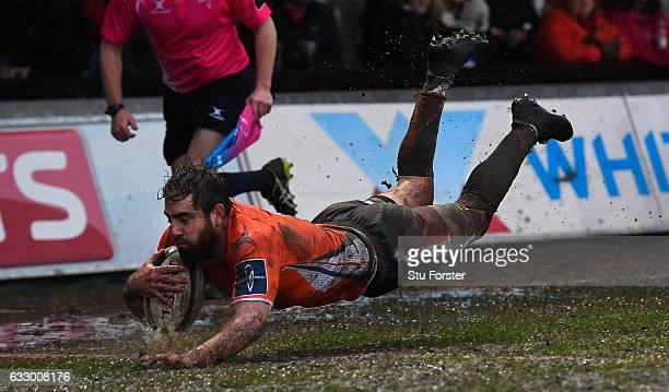 Falcons wing Belisario Agulla dives over the line to score during the Anglo Welsh Cup match between Newport Gwent Dragons and Newcastle Falcons at...