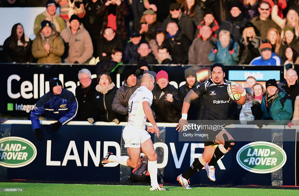 Falcons winger Alesana Tuilagi tears past Charlie Hodgson during the Aviva Premiership match between Newcastle Falcons and Saracens at Kingston Park on December 27, 2014 in Newcastle upon Tyne, England.