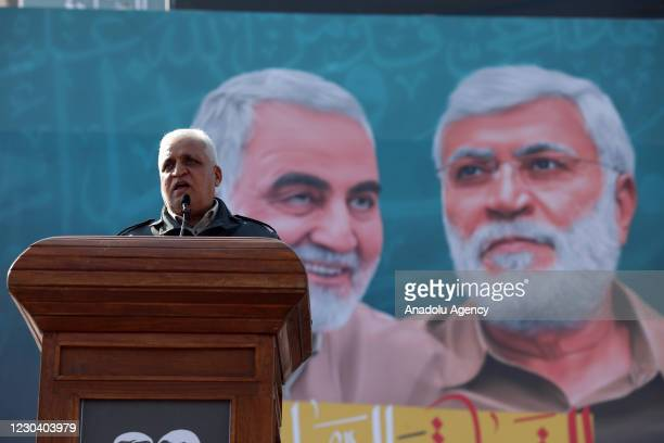 Faleh al-Fayyad, head of the Hashd al-Shaabi group makes a speech during a demonstration at Tahrir Square to commemorate the first anniversary of the...