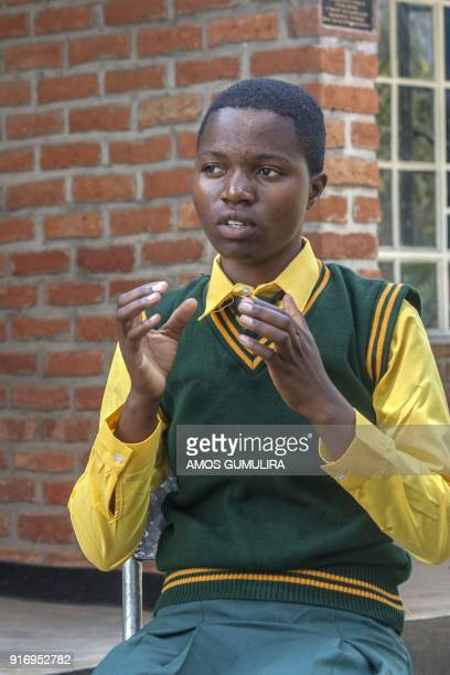 Falesi Samuel a Form Four Student at Atsikana Pa Ulendo Girls Secondary School speaks during an interview with Agence FrancePresse at the school on...