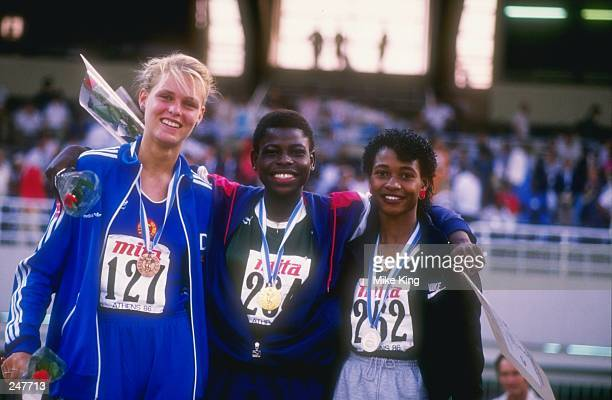 Falilat Ogunkoya of Nigeria wins the gold Mary Onyali of Nigeria wins the silver and Katrin Krabbe of East Germany wins the bronze in the 200 meters...