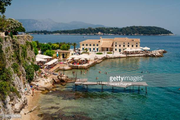 faliraki beach in corfu (greece) - corfu stock pictures, royalty-free photos & images