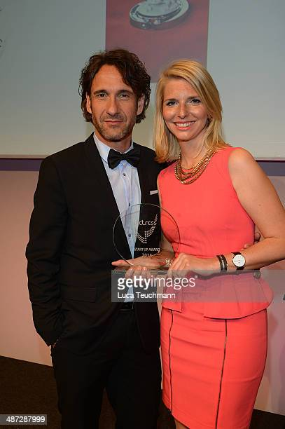 Falk Willy Wild and LeaSophie Cramer attend the 9th Victress Awards Gala at andels Hotel Berlin on April 28 2014 in Berlin Germany