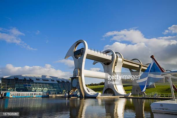 falkirk wheel under a beautiful blue sky. - scotland flag stock photos and pictures