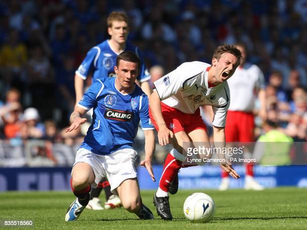 Falkirk's Neil McCann is brought down by and Rangers' Barry Ferguson