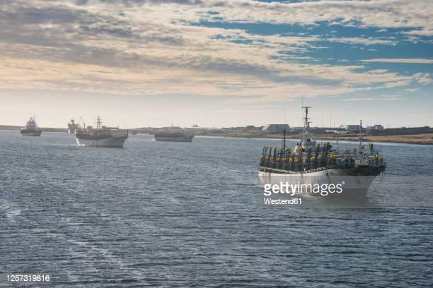 uk, falkland islands, stanley, fishing trawlers sailing near coast - フォークランド諸島 ストックフォトと画像