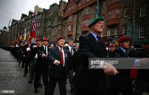 Falkland War Veterans stand to attention as they commemorate the 25th anniversary of the end of the Falklands conflict June 14 2007 in Edinburgh...