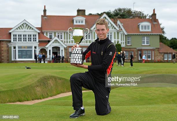 Falko Hanisch of Germany winner of the Boys Amateur Championship final at Muirfield poses for a photograph at the 18th green on August 14 2016 in...