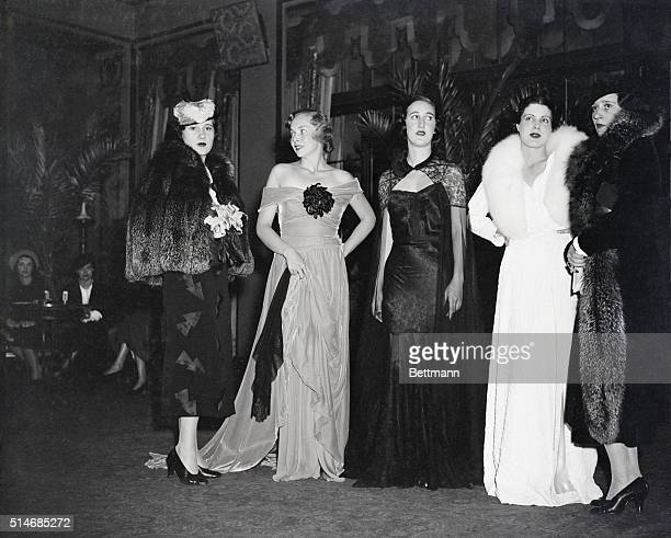Fall and winter fashions designed by Gloria Morgan Vanderbilt, right, and her sister, Thelma Lady Furness, left, are shown being worn by models at a...