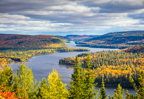 Fall colors in La Mauricie National Park with Wapizagonke lake and its Île aux pins (Pine Island), in Québec, Canada. 854098830