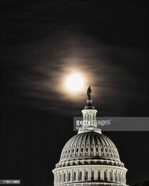 Fall Corn Moon rises over the United States Capitol Dome and the Statue of Freedom.