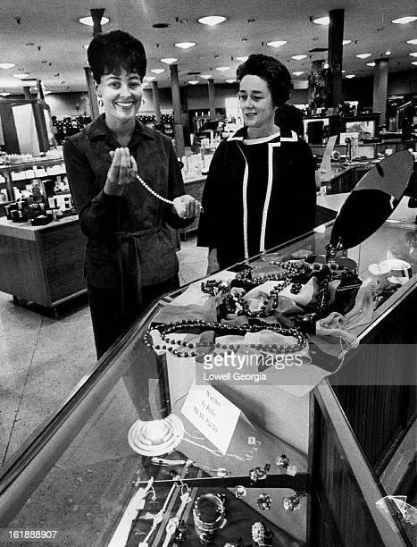 SEP 13 1963 SEP 14 1963 Fall Fashion Show Planned Wednesday Mrs Mark Farrell Jr left and Mrs Frank B McGlone select jewelry they will wear in...