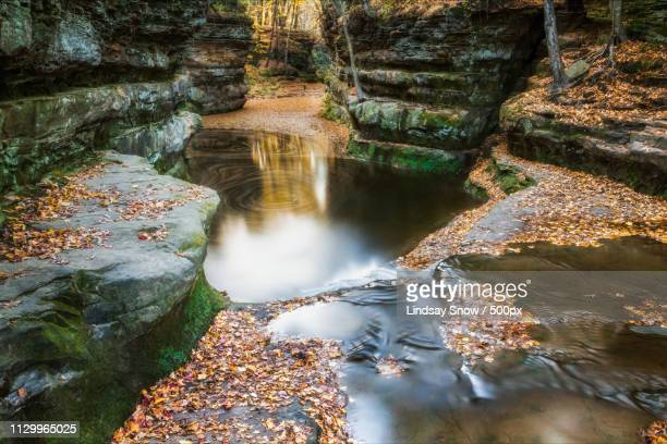 fall leaves at pewits nest, baraboo, wisconsin, usa - iron_county,_wisconsin stock pictures, royalty-free photos & images