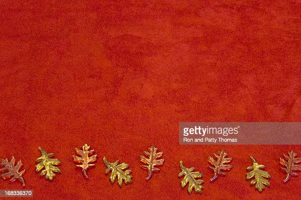 Fall leaves in glass on suede (P)