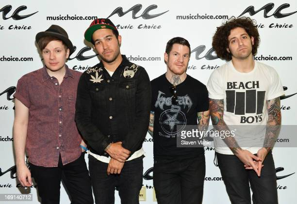 'Fall Out Boy' band members Patrick Stump Pete Wentz Andy Hurley and Joe Trohman visit 'UA' at Music Choice on May 20 2013 in New York City