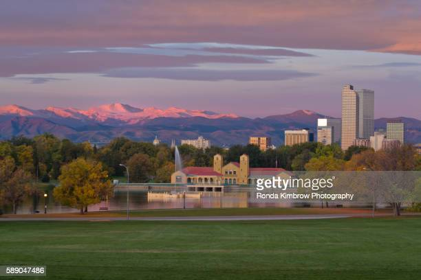 fall sunrise on denver's city park and skyline - denver stock photos and pictures