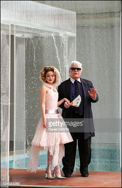 Fall Winter 2000 2001 Haute Couture fashion show : Chanel In Paris, France On July 11, 2000 - Karl Lagerfeld with model Devon Aoki.