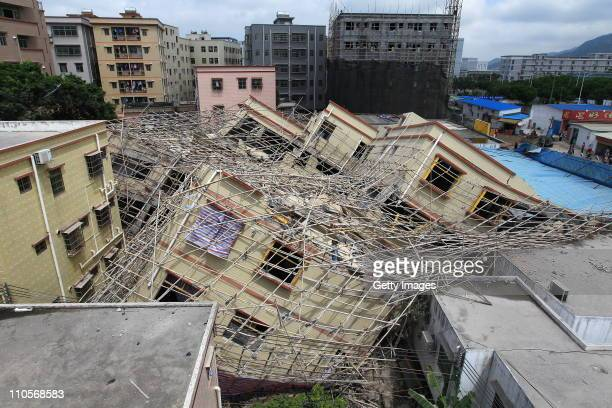 Fallen building is seen in Guangchang Village on March 21 2011 in Zhuhai Guangdong Province of China It's reported that the under construction...