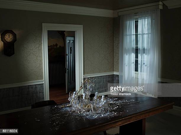 fallen chandelier on dining room table
