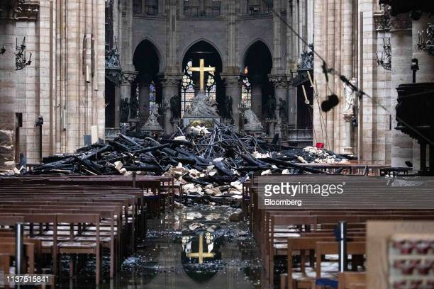 Fallen debris from the burnt out roof structure sits near the altar inside Notre Dame Cathedral in Paris France on Tuesday April 16 2019 Authorities...