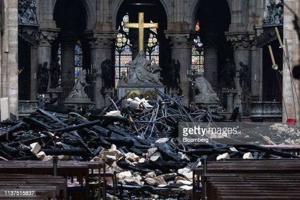 Fallen debris from the burnt out roof structure sits near the high altar inside Notre Dame Cathedral in Paris, France, on Tuesday, April 16, 2019....