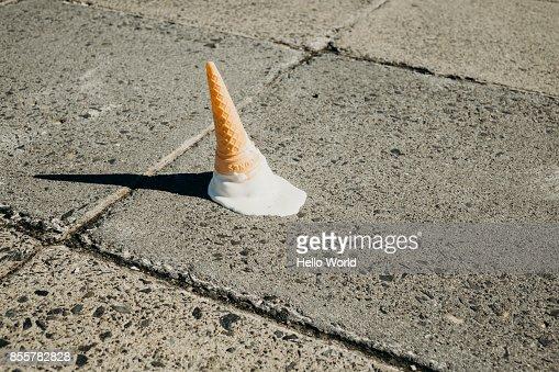 Fallen ice-cream cone on concrete floor