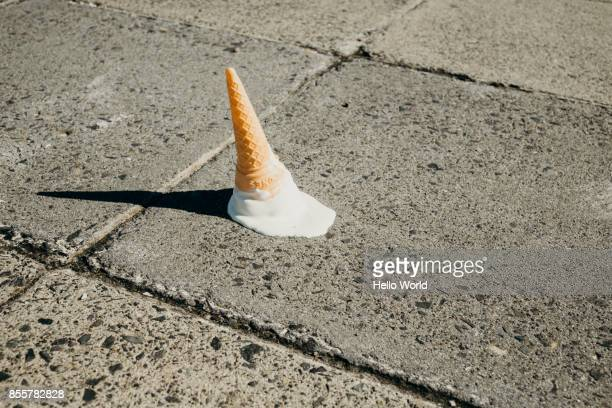 Fallen ice-cream cone on concrete floor
