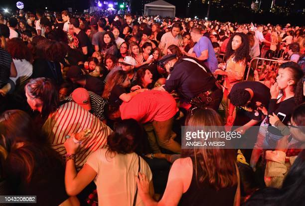 A fallen security barrier causes panic at the Global Citizen Festival in New York on September 29 2018