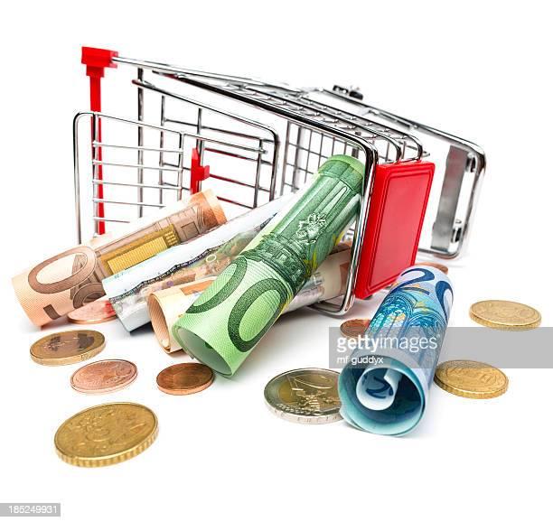 Fallen shopping cart with money inside