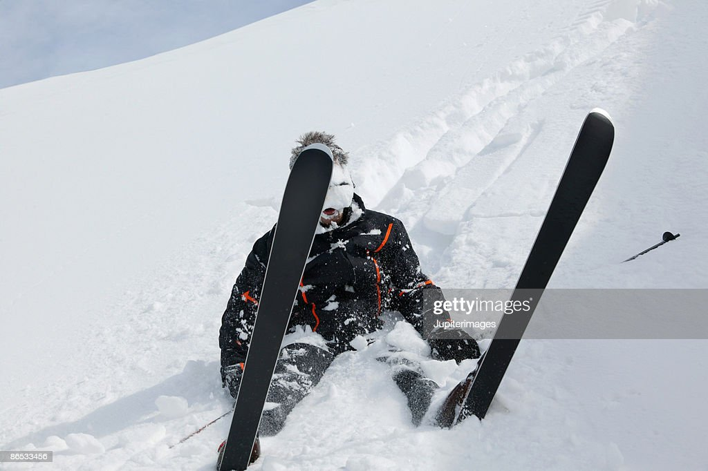 Fallen snow skier : Stock Photo